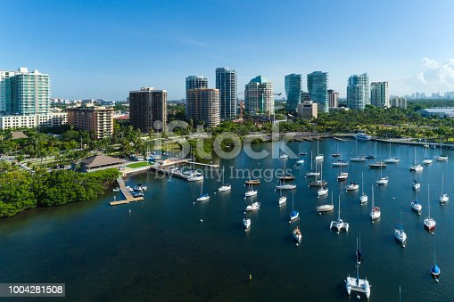 Panoramic view of Coconut Grove bay with a large group of boats anchored on the shore. Aerial view.