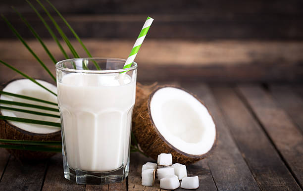 Coconut milk in the glass - foto de acervo