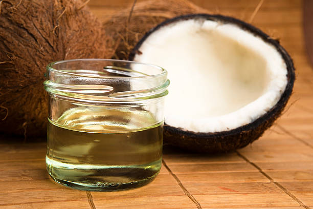 Coconut oil for alternative therapy stock photo