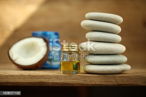 istock coconut oil for massage pebble candle 1028221102