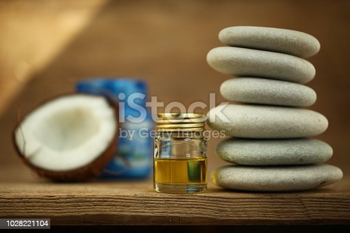 istock coconut oil for massage pebble candle 1028221104