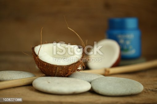 istock coconut oil for massage pebble candle 1028221366