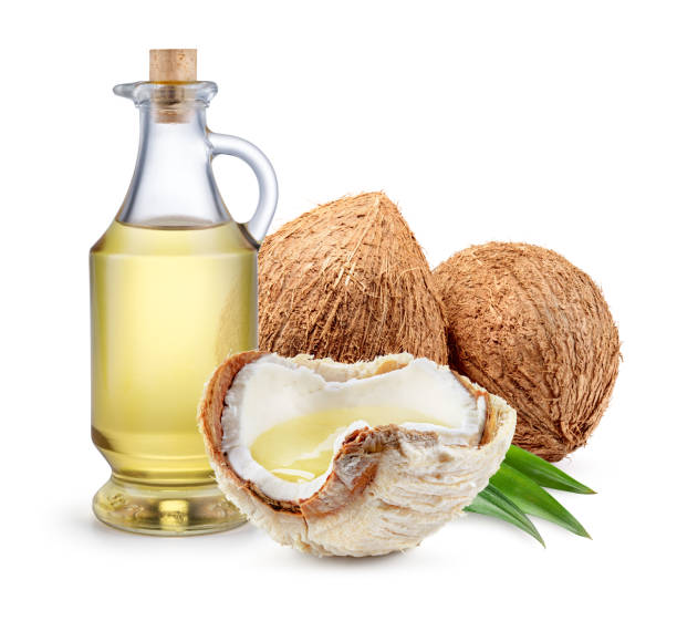 coconut oil. fresh coconut with oil isolated on white background. full depth of field. - coconut oil stock pictures, royalty-free photos & images