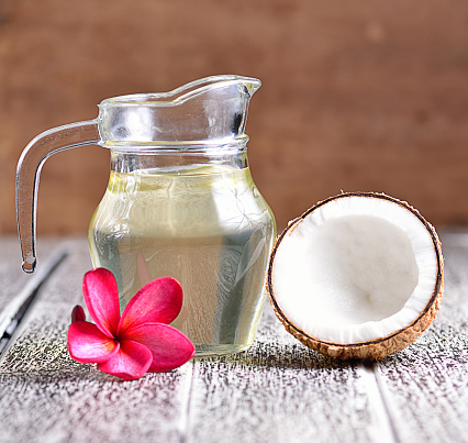 istock coconut oil isolated on wooden background. 489529102