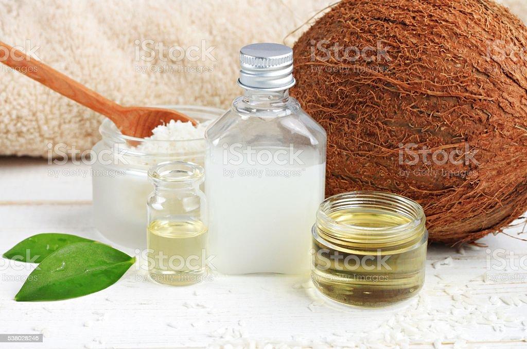 Skincare benefits. Bottles coconut oil, coconut milk, shavings.