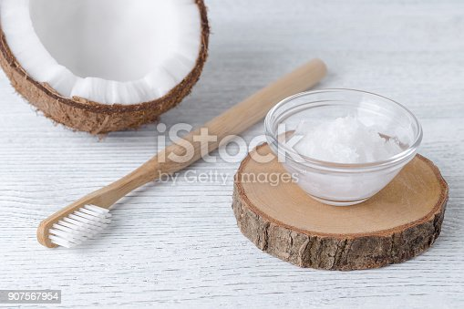istock coconut oil toothpaste, natural alternative for healthy teeth, wooden toothbrush 907567954