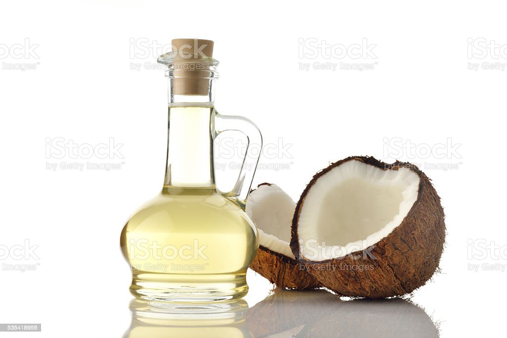 Coconut Oil with Coconuts on White Background stock photo