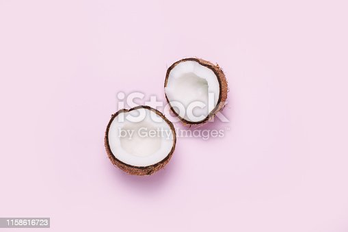 istock Coconut on pink background. Minimal concept. 1158616723