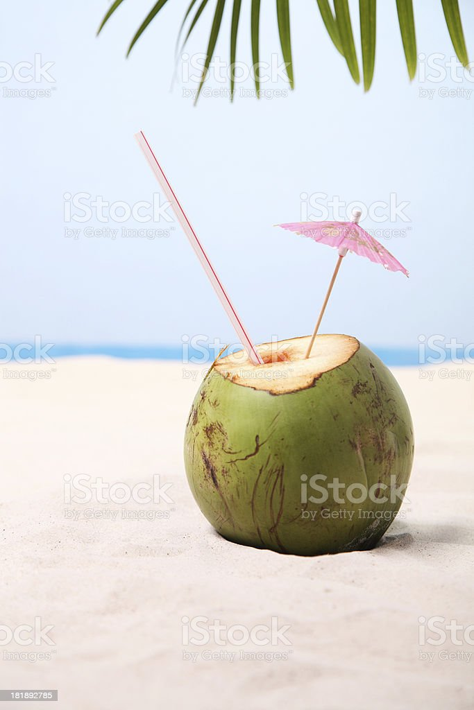 Coconut on sand stock photo