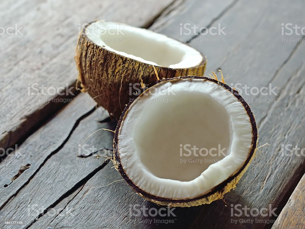 coconut on wooden background stock photo
