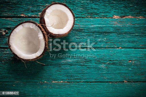 istock Coconut on wooden table.Organic healthy food concept.Beauty and SPA concept. 610688422