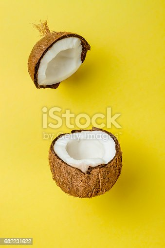 istock Coconut on yellow colored background, minimal flat lay style 682231622
