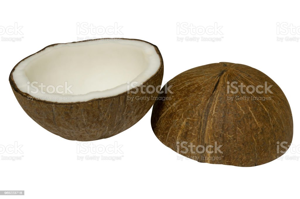 Coconut peeled and broken into half on white background with clipping path zbiór zdjęć royalty-free