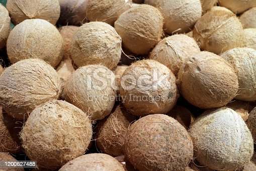 A heap of peeled coconut at market place