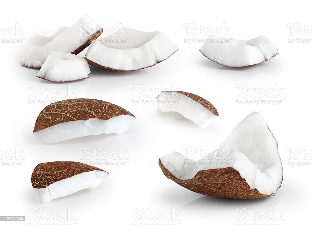 Coconut pieces isolated on a white background. stock photo
