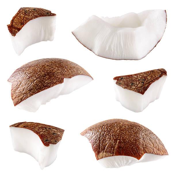 kokosnuss.  stücke, isoliert auf weißem hintergrund - 25 cent stück stock-fotos und bilder