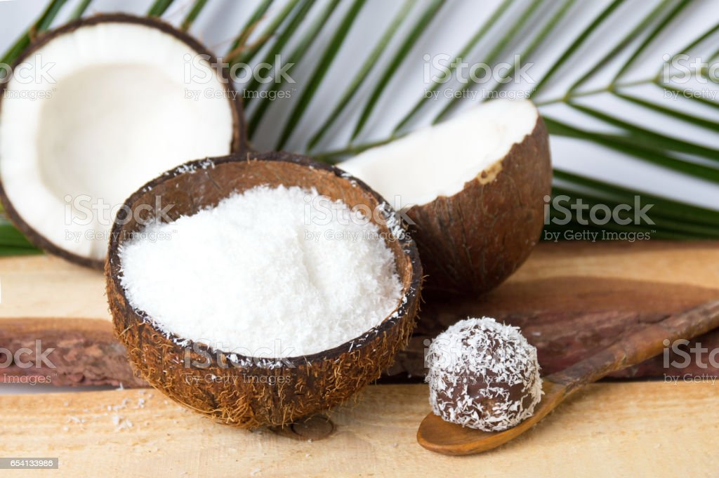 Coconut powder in a natural shell stock photo