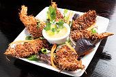 Deep fried coconut shrimps close up