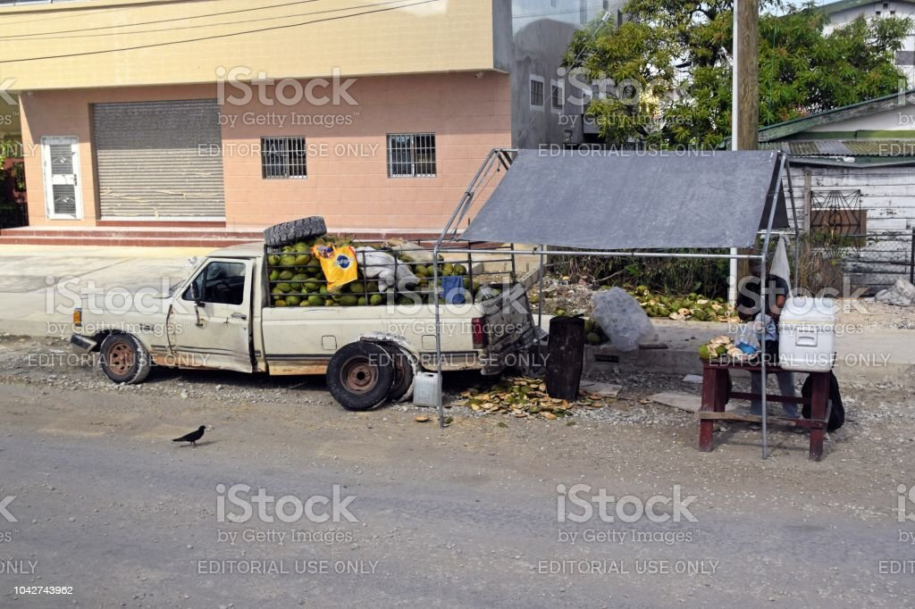 Coconut stall on the street in Belize City stock photo