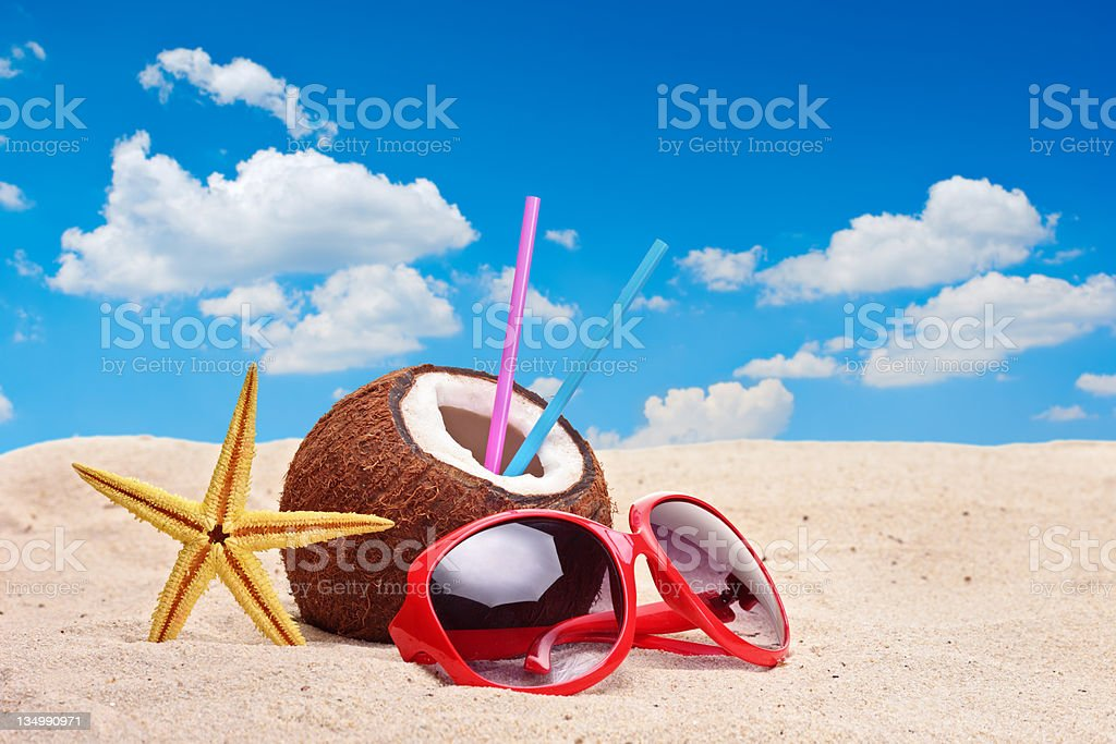 Coconut, starfish and a sunglasses royalty-free stock photo