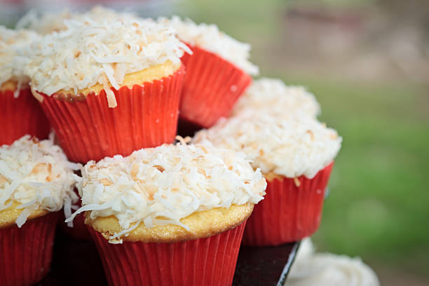 Coconut topped cupcakes stock photo