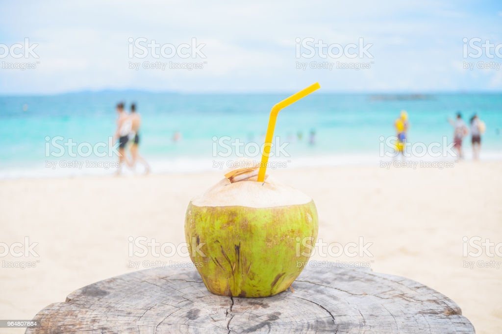 Coconut water is on a beautiful sandy beach. royalty-free stock photo