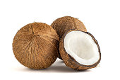 Coconut. Whole and half isolated on white background. Side view