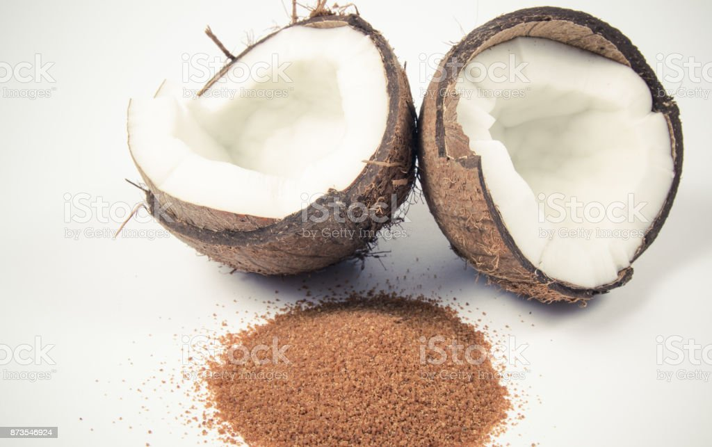 Coconut with coconut sugar isolated on white background. stock photo