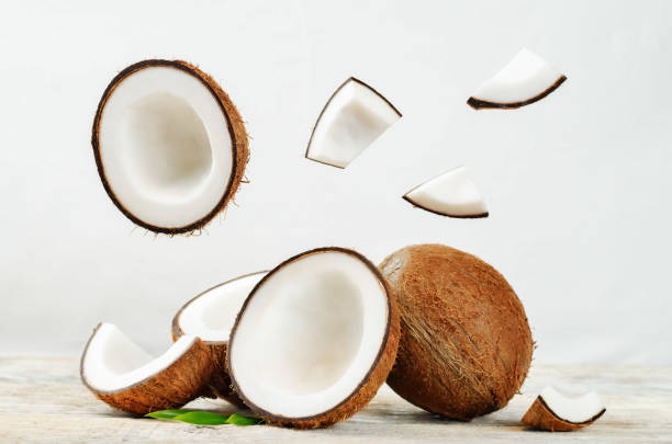 Coconut with flying slices stock photo