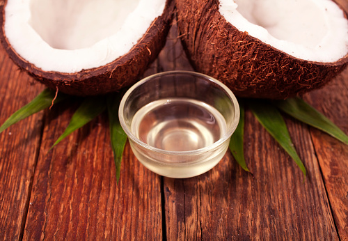 istock Coconut with melted coconut oil 1053941426