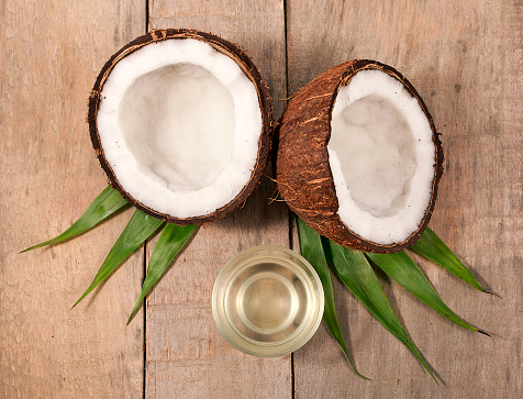 istock Coconut with melted coconut oil 1053941508