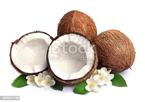 Coconut with white flowers close up on white backgrounds.