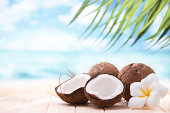 Coconuts on the beach with copy space