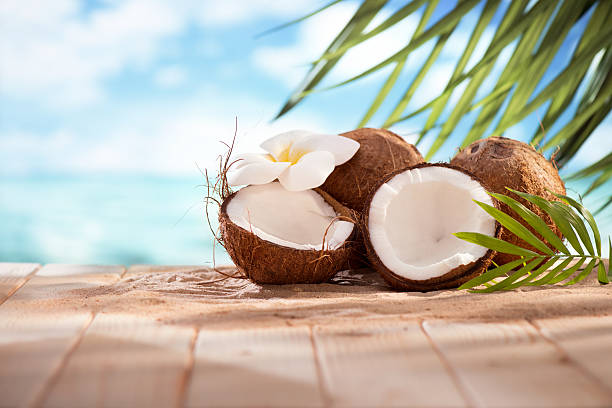Coconuts on the beach with copy space stock photo