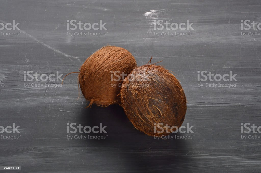 Coconuts on Wood Background stock photo