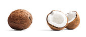 Two coconuts on white, ideal for placement in product photos.  One coconut is cracked open, and one is whole.