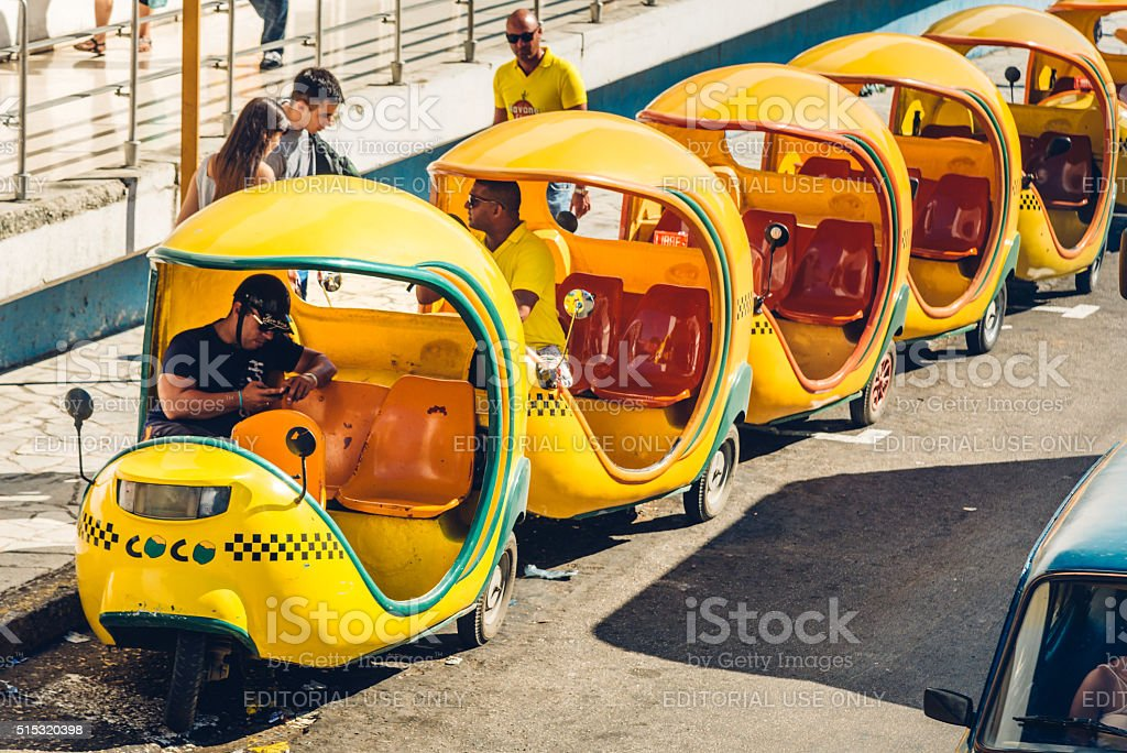 Coco-taxis in Havana waiting for clients stock photo