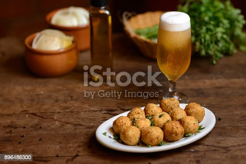 Traditional portuguese Cod fish croquette on the table ready for eat.