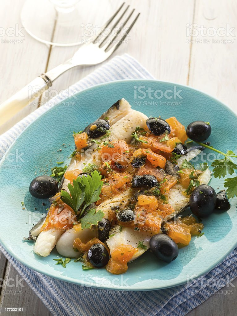 cod fillet with black olives and fresh tomatoes royalty-free stock photo