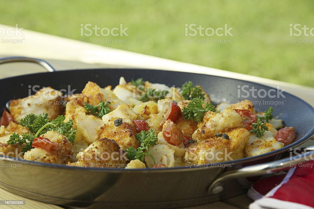 Cod fish and tomatoes in the pan. Westfjords-Iceland. royalty-free stock photo