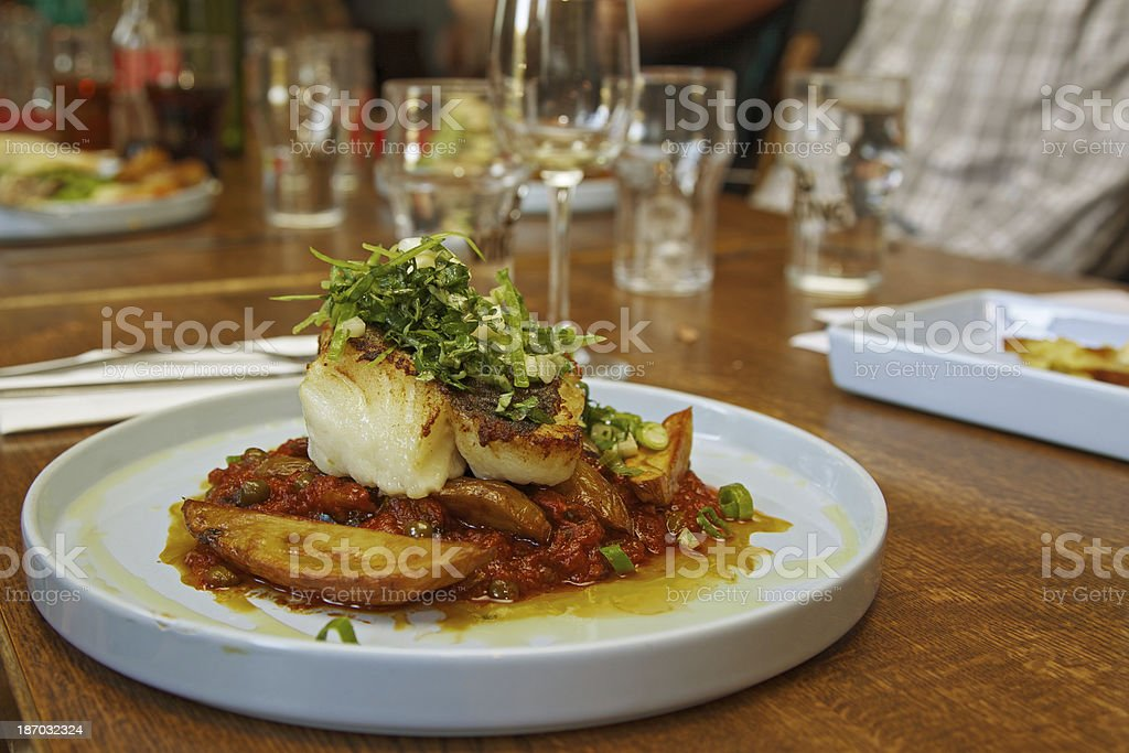 Cod fish and tomatoes in the resaturant. Westfjords-Iceland. stock photo