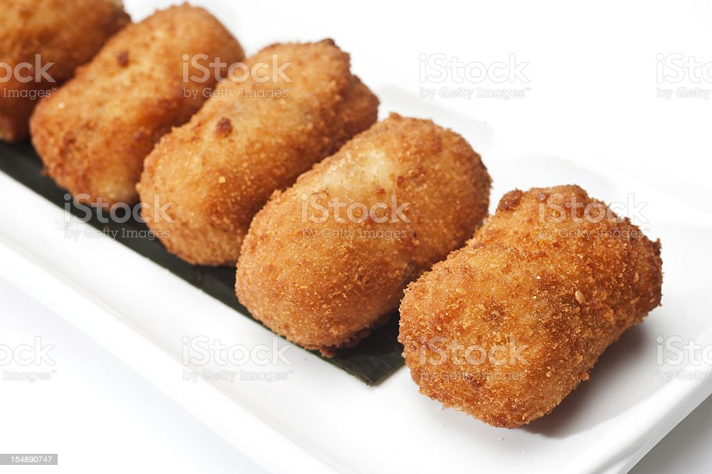 Cod Fish Croquettes on white background​​​ foto