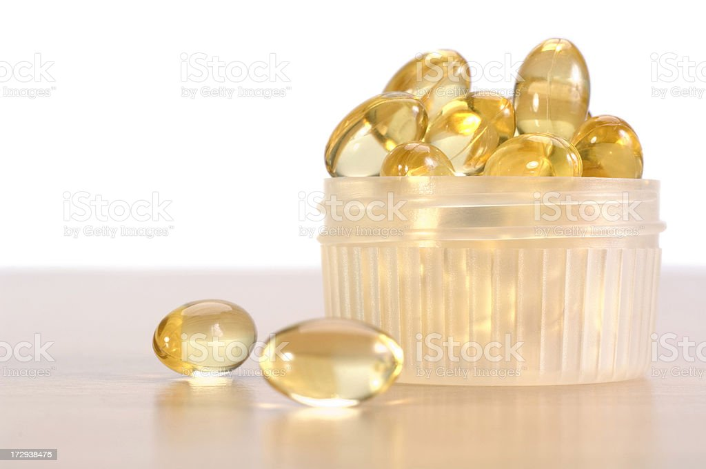 Cod liver oil supplement pills royalty-free stock photo