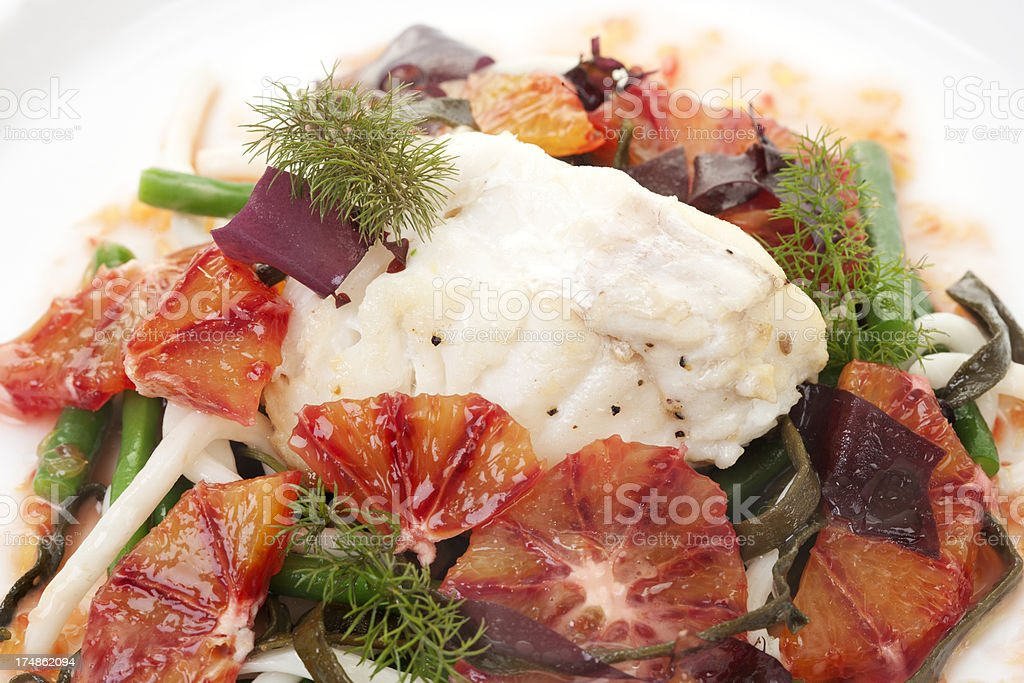cod with blood orange and sea vegetables royalty-free stock photo