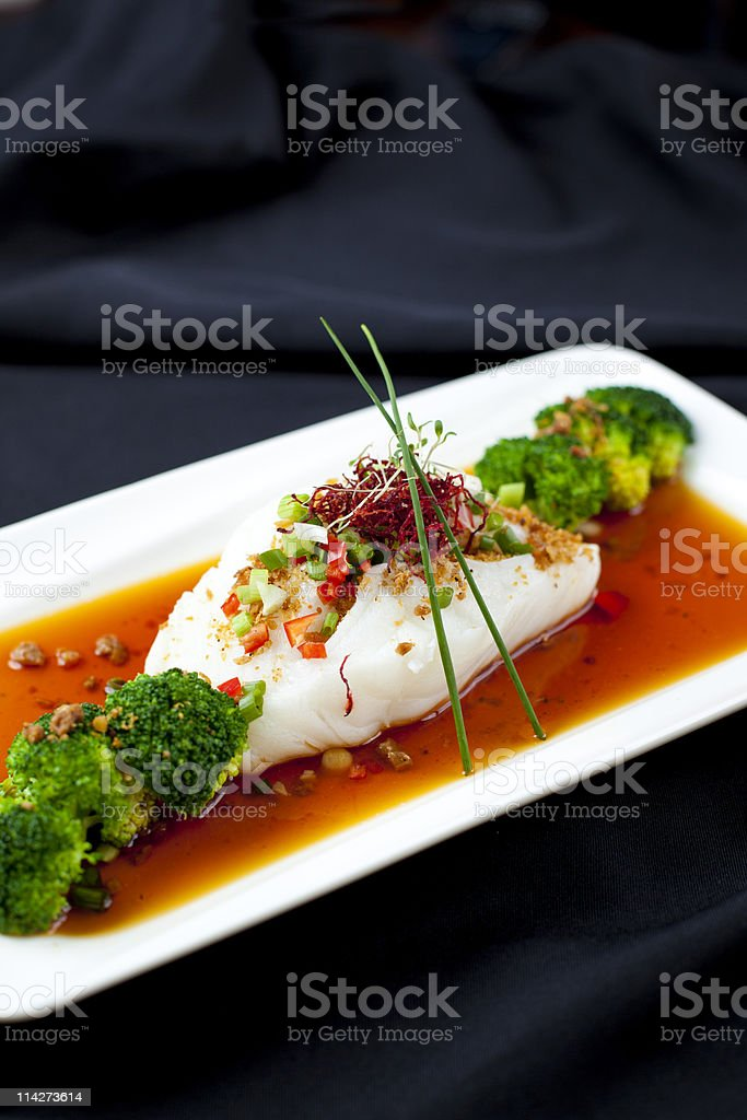 Cod with Broccoli stock photo