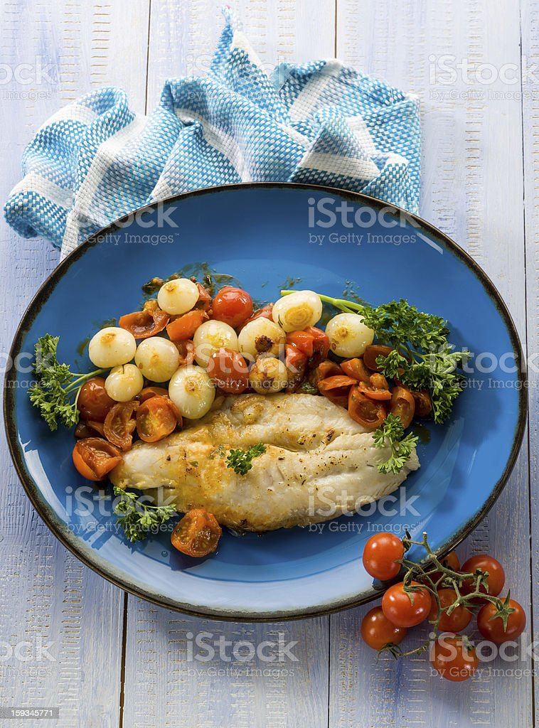 cod with onions and tomatoes sauce royalty-free stock photo