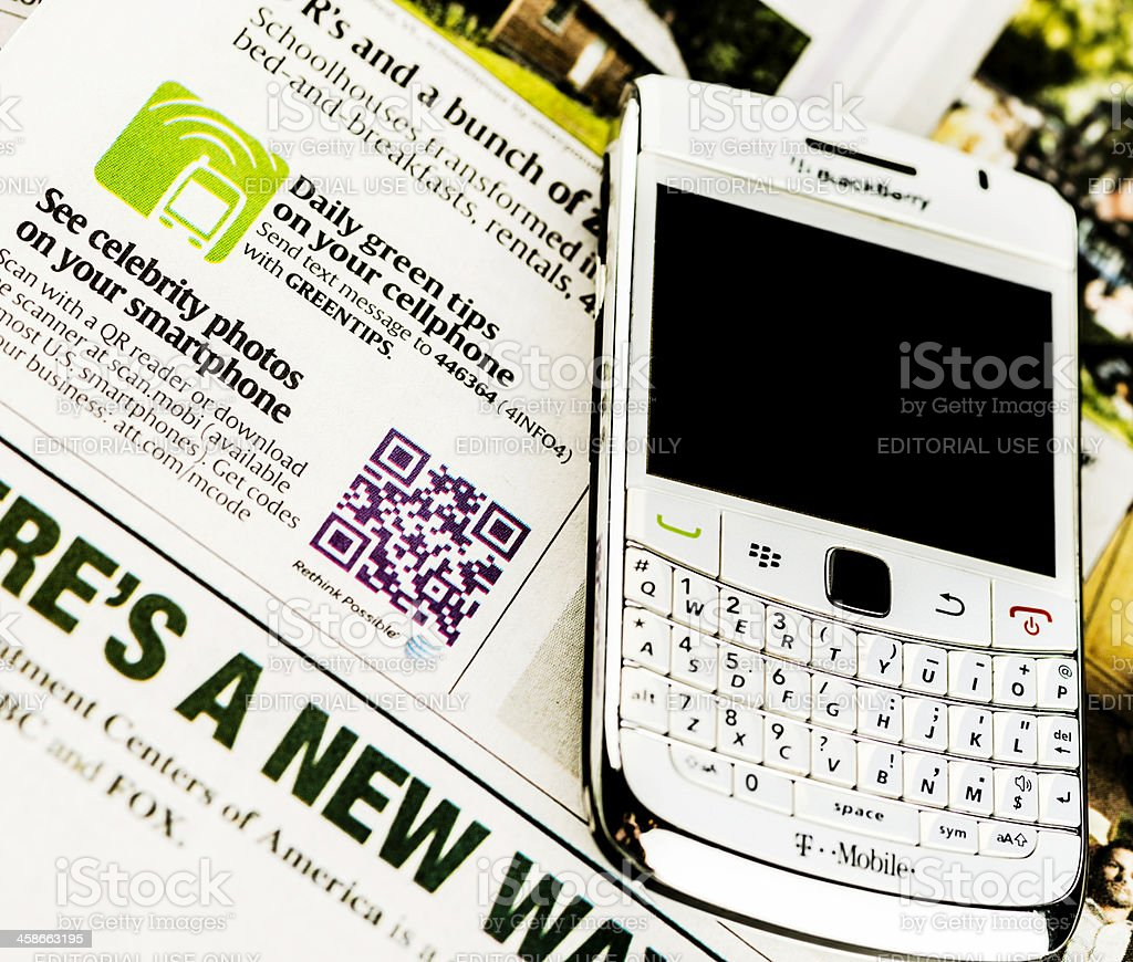 QR Code For Entertainment and Blackberry Bold Mobile Phone stock photo