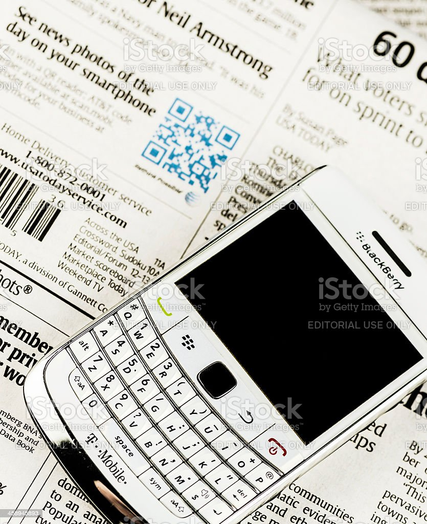 QR Code For News Photos and Blackberry Bold Mobile Phone royalty-free stock photo
