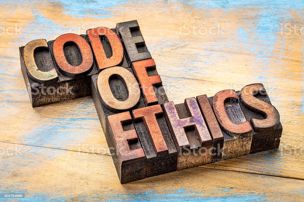 code of ethics bannert in wood type stock photo