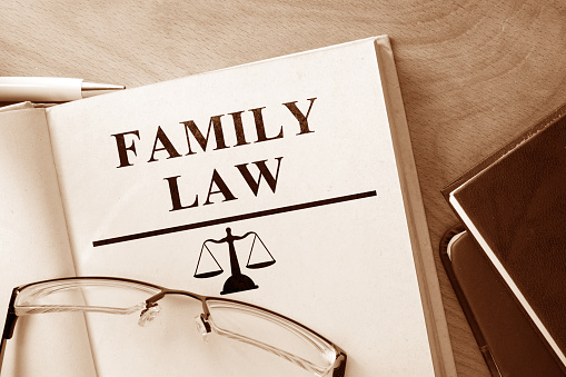 Code of  family law on a wooden table.